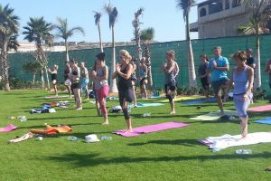 Yoga Retreat Secrets Puerto Los Cabos - Group Yoga Class Outside! Calgary travel vacation experience with a group of people. Get out of town to enjoy the sunshine, daily meals, yoga classes, and accommodation.