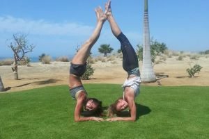 Yoga Retreat Secrets Puerto Los Cabos - Inversion Fun! Calgary travel vacation experience with a group of people. Get out of town to enjoy the sunshine, daily meals, yoga classes, and accommodation.