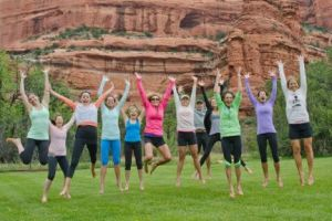 Yoga Retreat Sedona, Arizona - Group Photo Jumping! Calgary travel vacation experience with a group of people. Get out of town to enjoy the sunshine, daily meals, yoga classes, and accommodation.