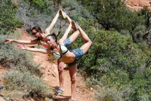Yoga Retreat Sedona, Arizona - Pair Yoga - Dancers Pose! Calgary travel vacation experience with a group of people. Get out of town to enjoy the sunshine, daily meals, yoga classes, and accommodation.